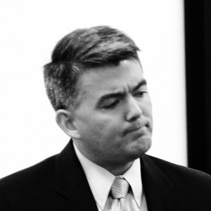 Cory Gardner (not smiling).