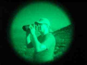Sen. Kent Lambert using night vision scope on the Mexican border.