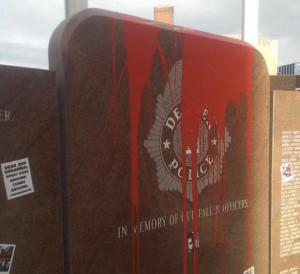 Defaced Denver Police memorial.