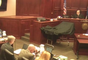 Arapahoe County D.A. George Brauchler (far left) is reprimanded by Judge Carlos Samour in court this morning.