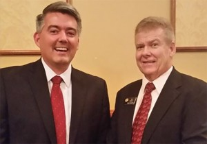 Sen. Cory Gardner, left, poses for an awkward photo with state Sen. Tim Neville