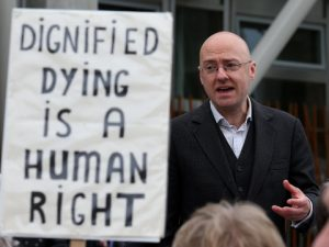 euthanasia-supporter-speaks-with-other-supporters-outside-scottish-parliament