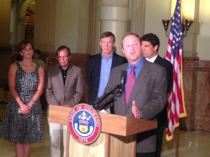 Rep. Jared Polis speaks at a press conference with Gov. John Hickenlooper.