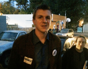 James OKeefe, wearing a Mark Udall sticker.