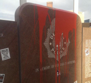 Defaced Denver Police memorial.
