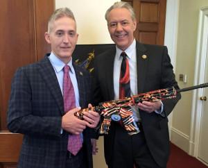 Rep. Ken Buck (right), with his gun.