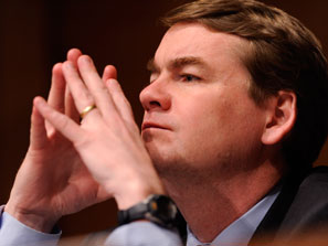 Sen. Michael Bennet (D-Denver) attempts to count the number of Republican Senate candidates with two hands.